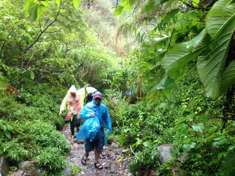 During our trek, rain started pouring. Some wore rain coats.