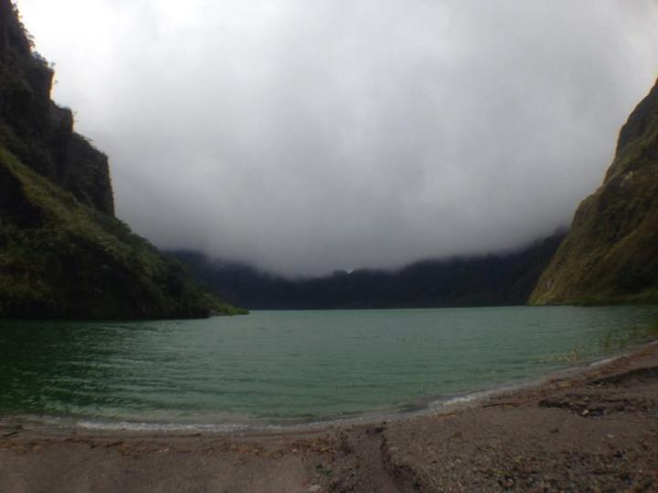 Lake Pinatubo is as calm as field and as green as a tree.