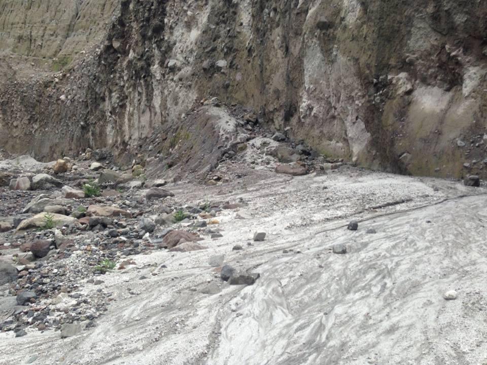 Rocks are scattered at the base of cliffs.