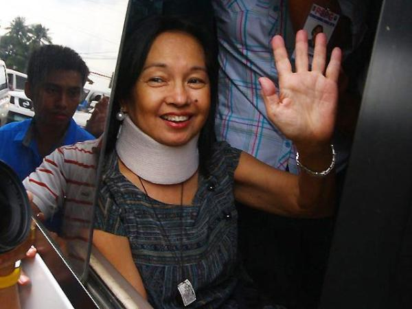 My face, frozen and immortalized in the car window of former President Gloria Macapagal-Arroyo. Photo shot by Asti Flores.