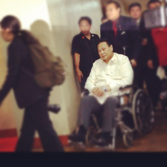 Impeached Chief Justice Renato Corona in a wheelchair.