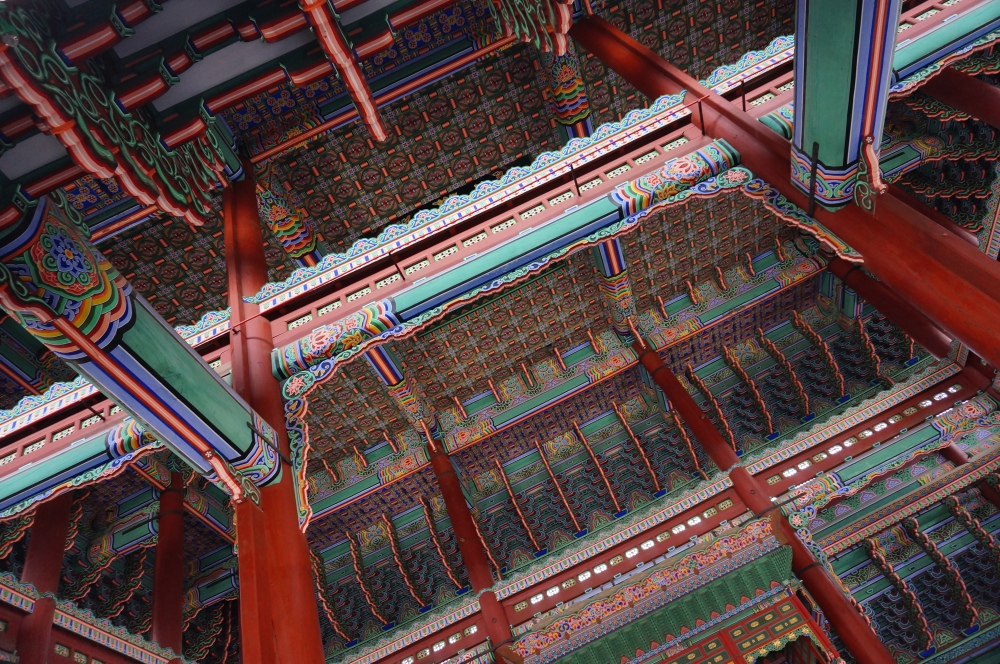The throne hall of Gyeongbokgung features an intricately painted ceiling. Destroyed by invaders and restored several times, this building is proof of South Korea's commitment when it comes to restoring heritage sites