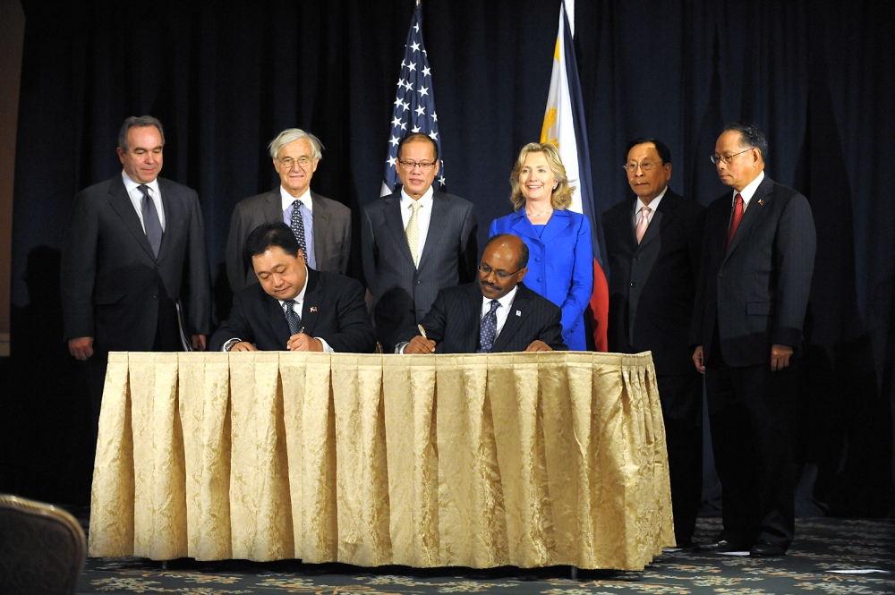 U.S. Secretary of State Hillary Rodham Clinton and U.S. Secretary of State Kurt M. Campbell (far left) pose for a photo at a Millennium Challenge Cooperation signing ceremony with Philippine President Aquino at the Waldorf-Astoria in New York, New York, on September 23, 2010.