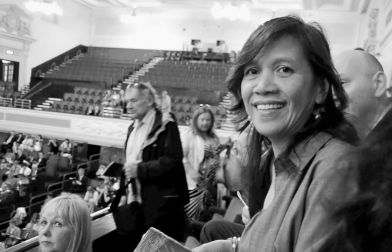 My mama smiles as she watches my sister graduate. A smile of victory.