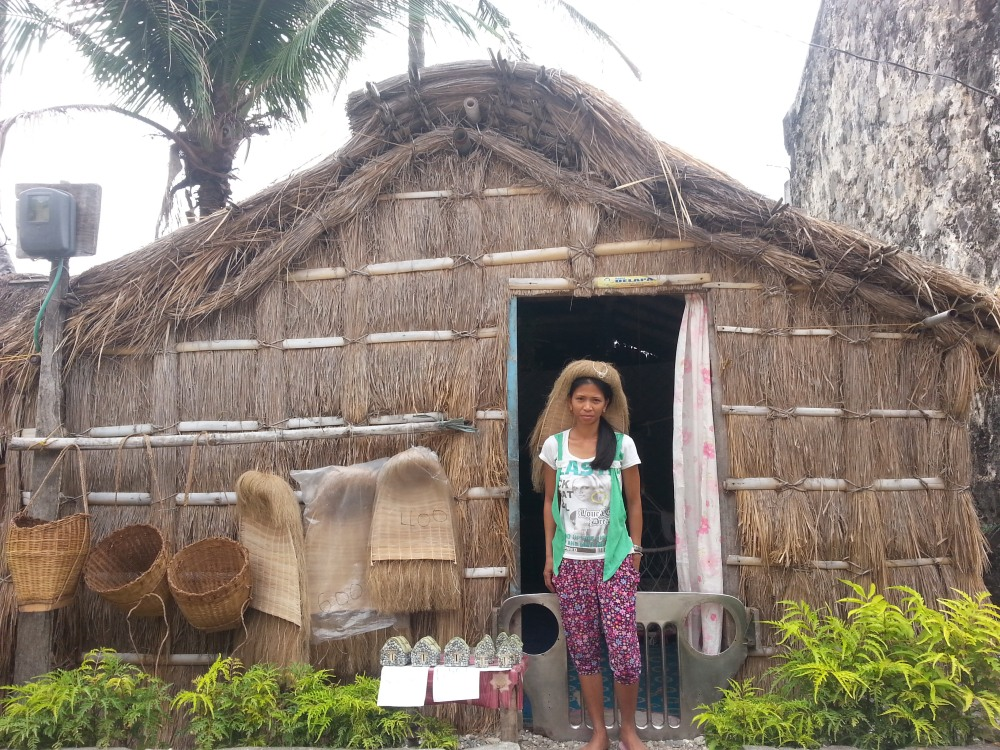 A woman sells vakul and kanayi for P300-P450 in an old Batan village. In Batanes, it seems everyone knows everybody.
