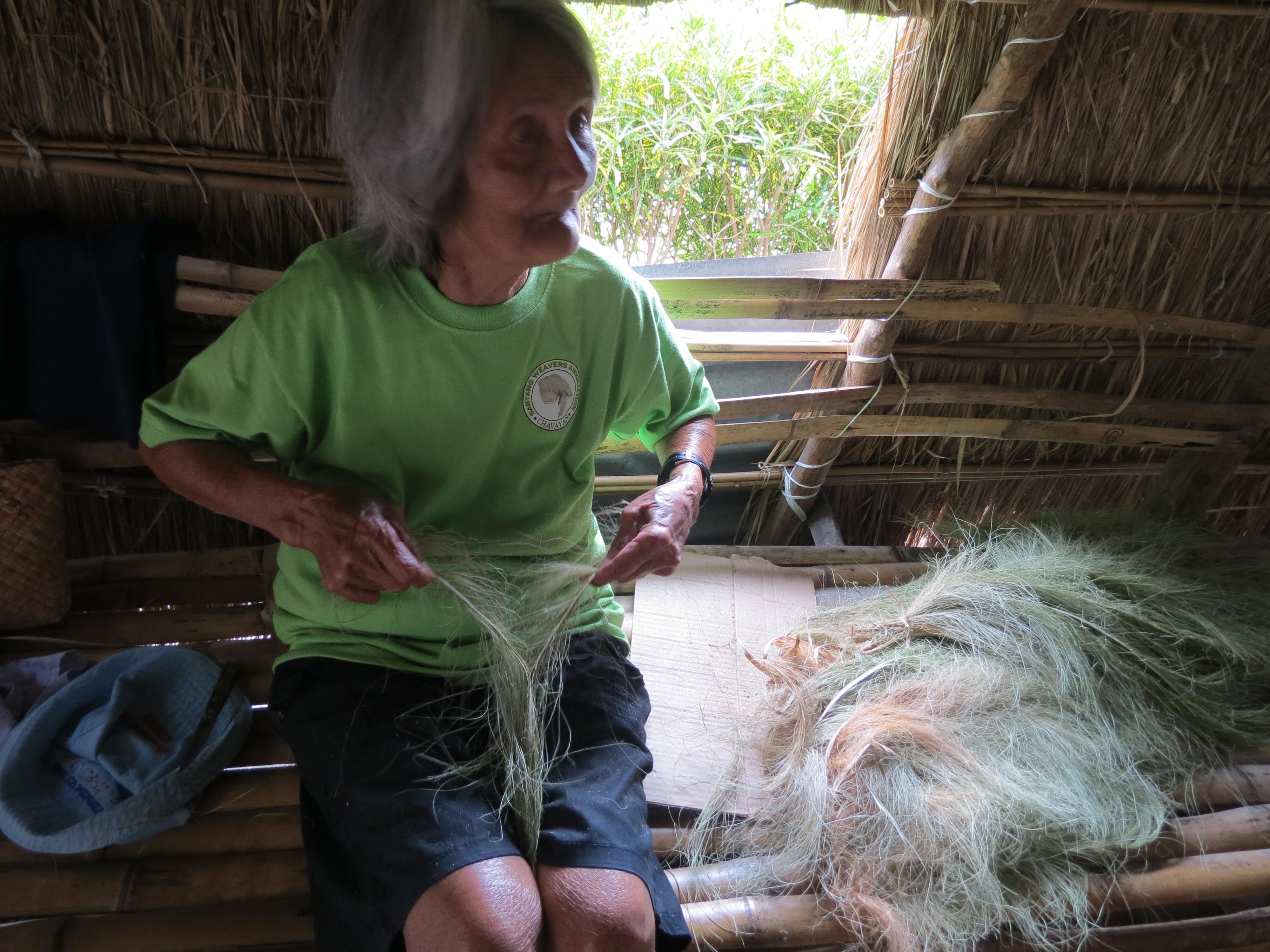 Lola Emila, an Ivatan weaver shows me how to weave fresh buyaboy into a vakul