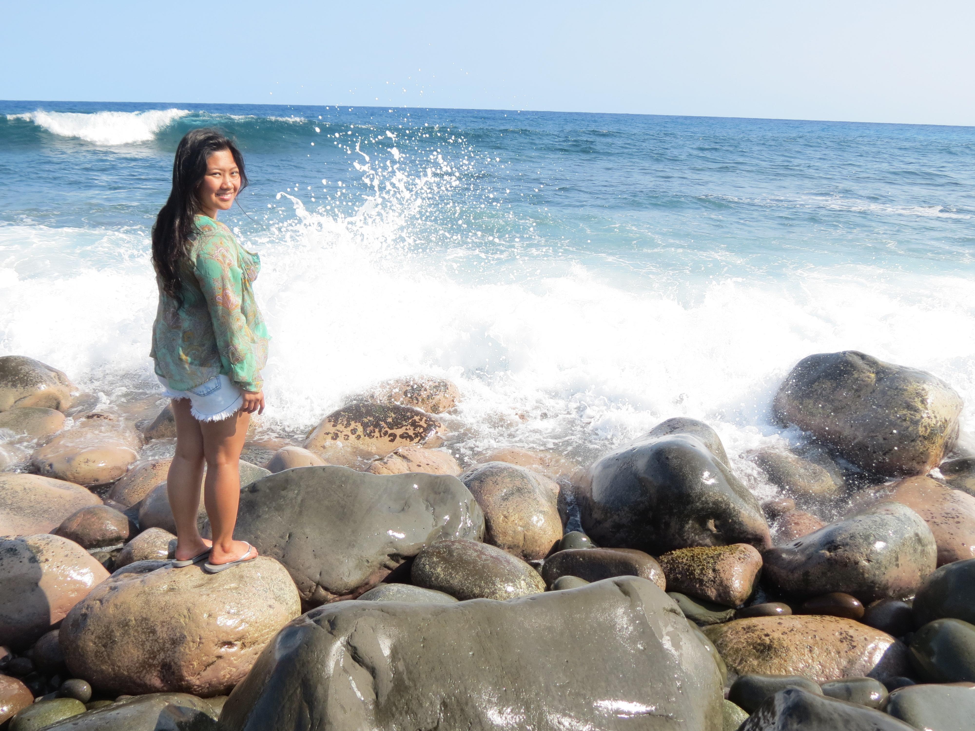 Strong waves smashing against volcanic rocks