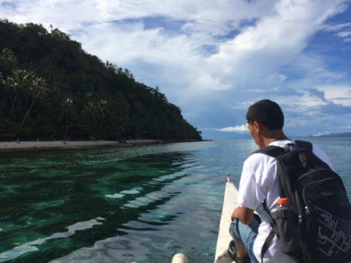Manny Janoyan sails to Limasawa Island every school year to teach children. (Photo by Lian Buan)