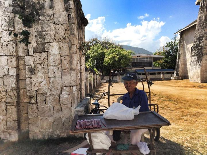 A candle vendor by the Church in Oslob, Cebu. (Photo by Lian Buan)