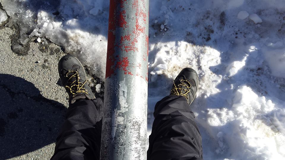 Stepping through. The Italian-Swiss border at the Great Saint Bernard Pass.