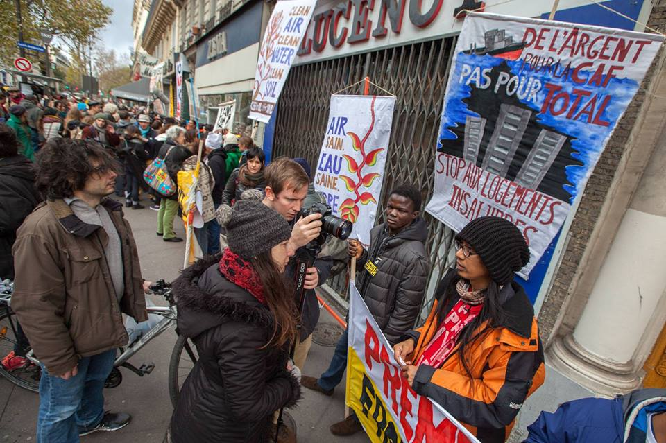 Paris 2015. Together with Tashi of the People's Pilgrimage and Japy of RARE, I stood along the indigenous people from all over the world in this segment of the #HumanChain for #ClimateJustice. Photo by Mona Caron.
