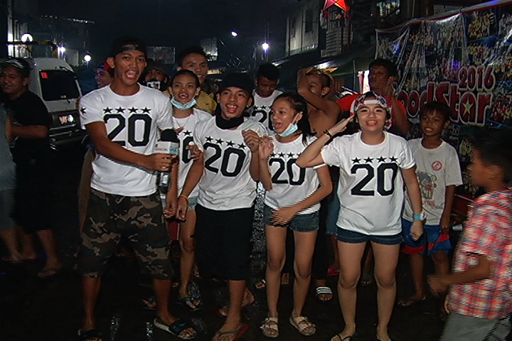 Residents of Dagupan Street during their New Year party. They even designed identical shirts to show their unity.