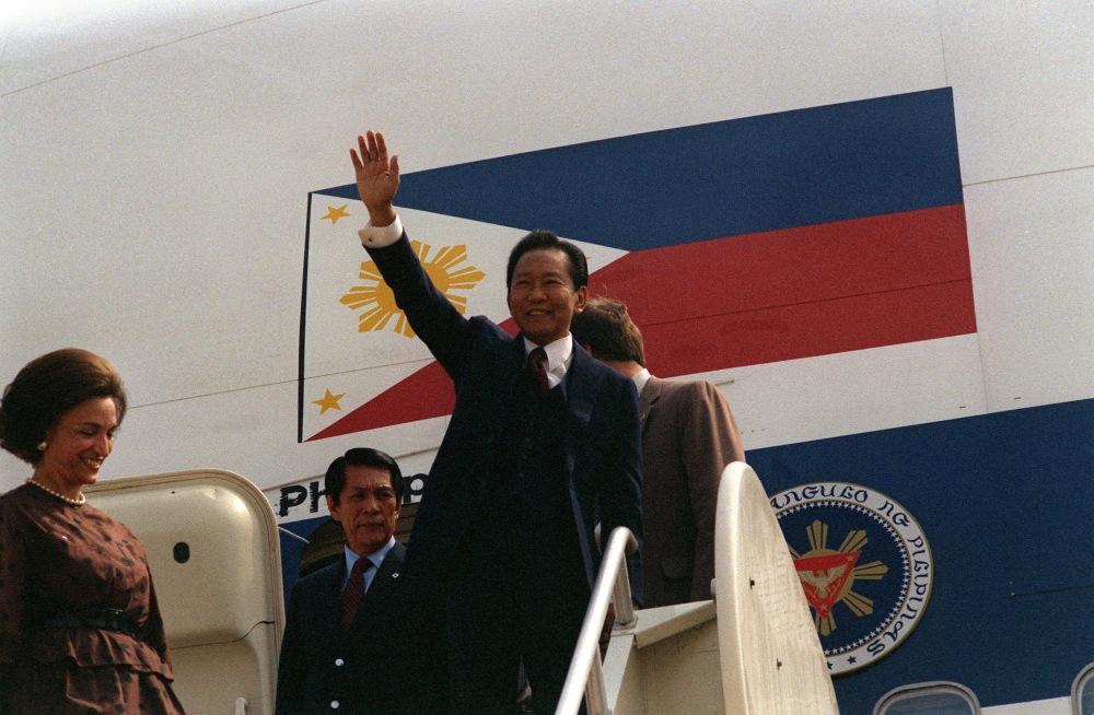 President Ferdinand E. Marcos of the Philippines pauses to wave to the people waiting to welcome him as he arrives for a visit to Washington D.C. He was joined by the Minister of National Defense Juan Ponce Enrile.