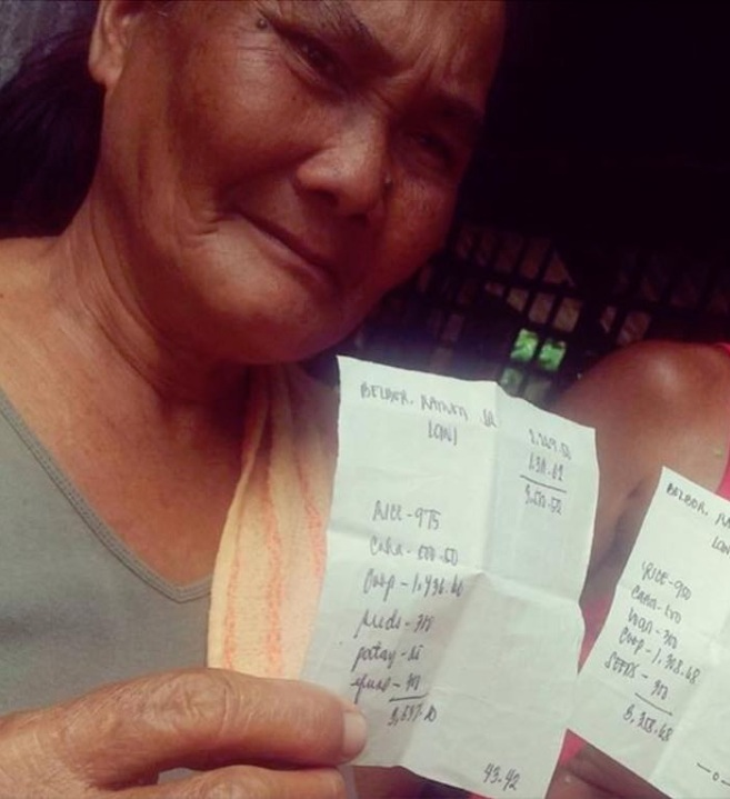 Lani, a sugar farmworker, shows her one dollar payslip for 15 days of work. (Photo from the National Federation of Sugar Workers)