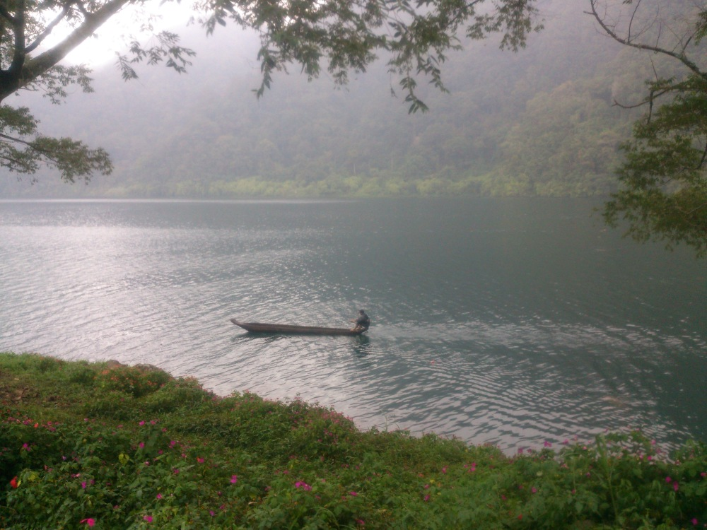A Tboli man in a traditional dugout canoe paddles through Lake Holon in Mt Melibingoy_2015