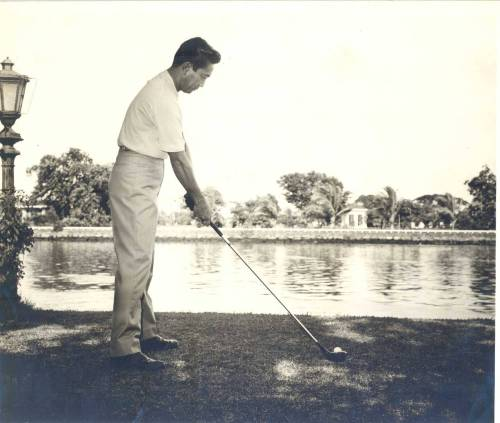 Ferdinand Marcos Playing Golf